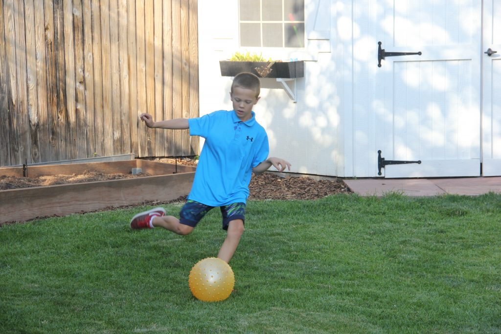 Jude's favorite thing to do, soccer in the backyard