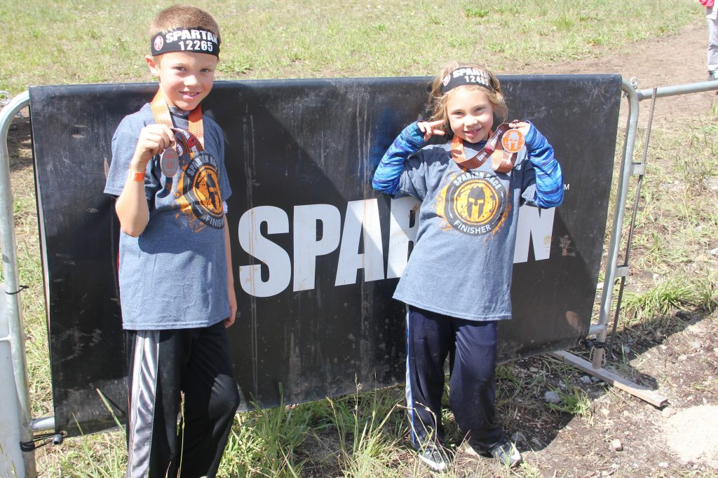 Showing off their medals after the race