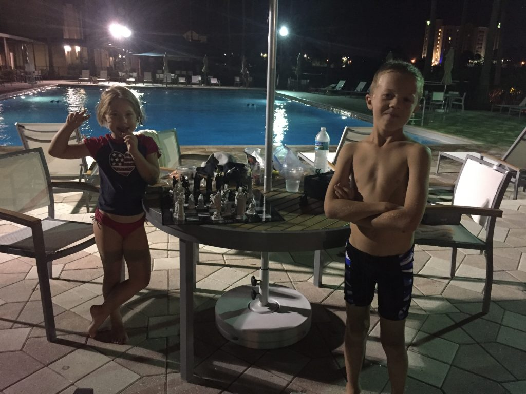 Playing chess by the pool on the last night