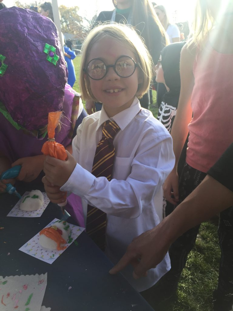 At the school Harvest Festival dressed as Harry Potter