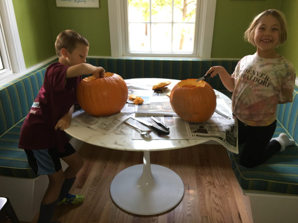 Carving pumpkins the day before Halloween
