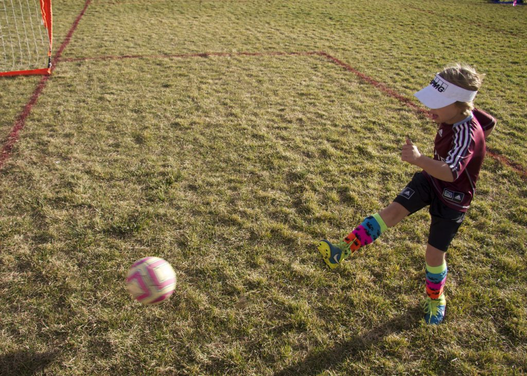 Anna practicing before her game started on Saturday morning