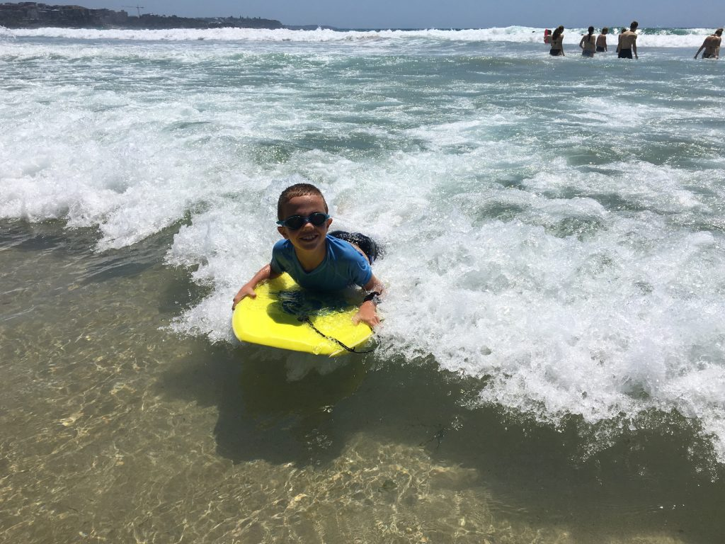 Jude catching a wave at Manly Beach