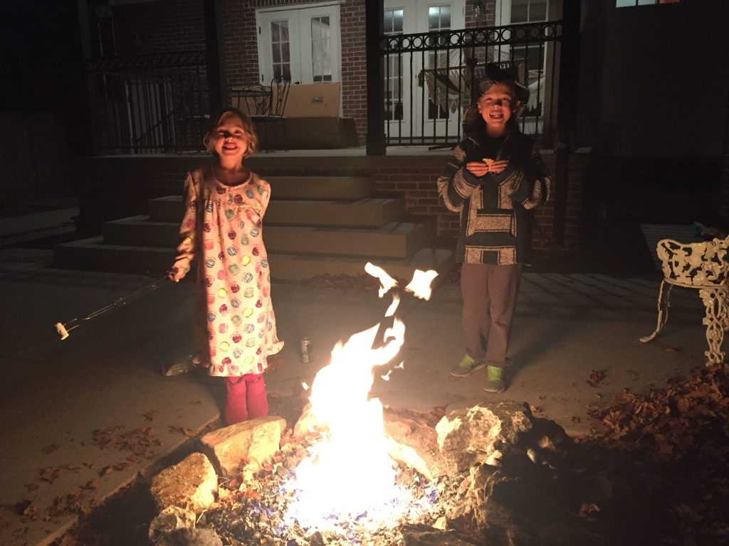 Anna and Jude roasting marshmallows on our last night in our old house