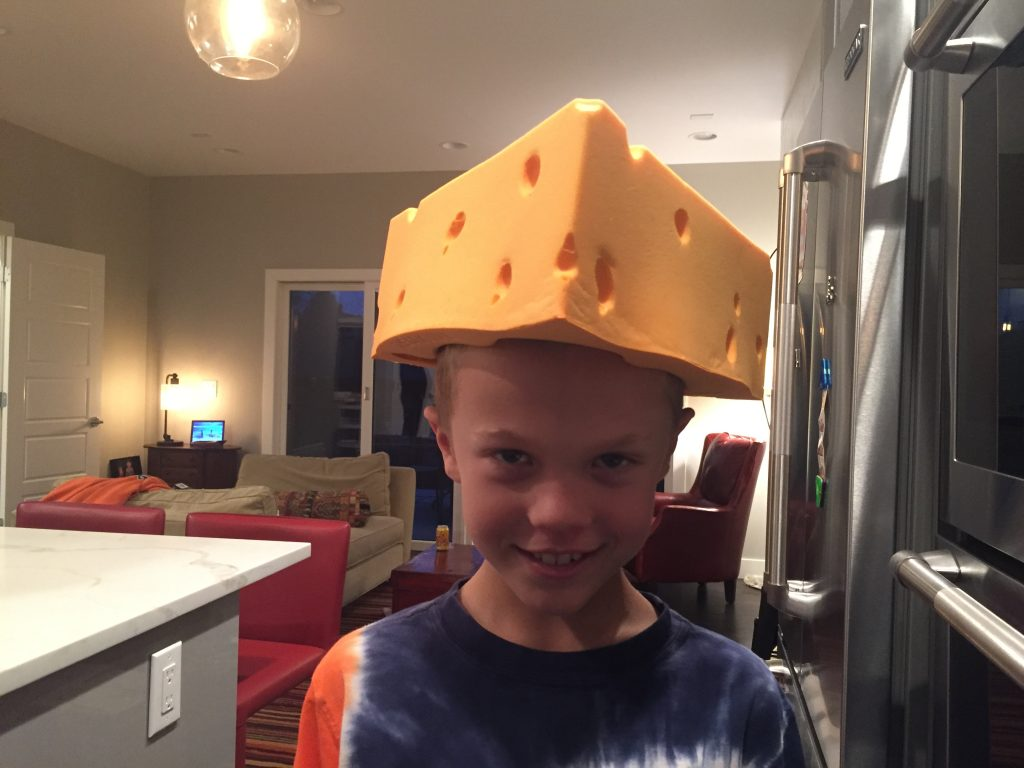 Jude receives a cheesehead from Uncle Nathan