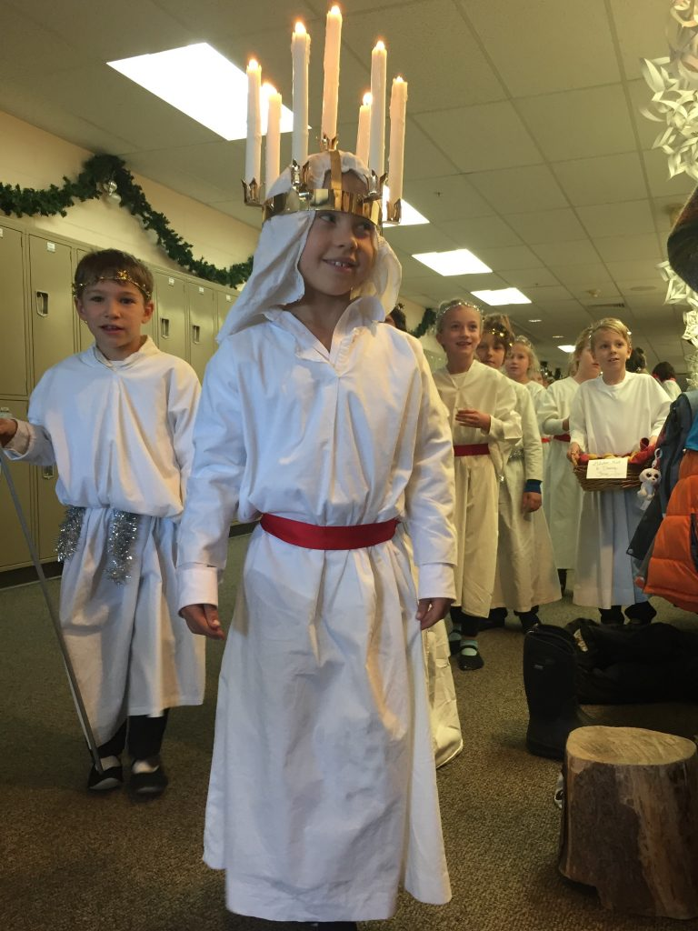 Anna leads her class in the Santa Lucia celebration