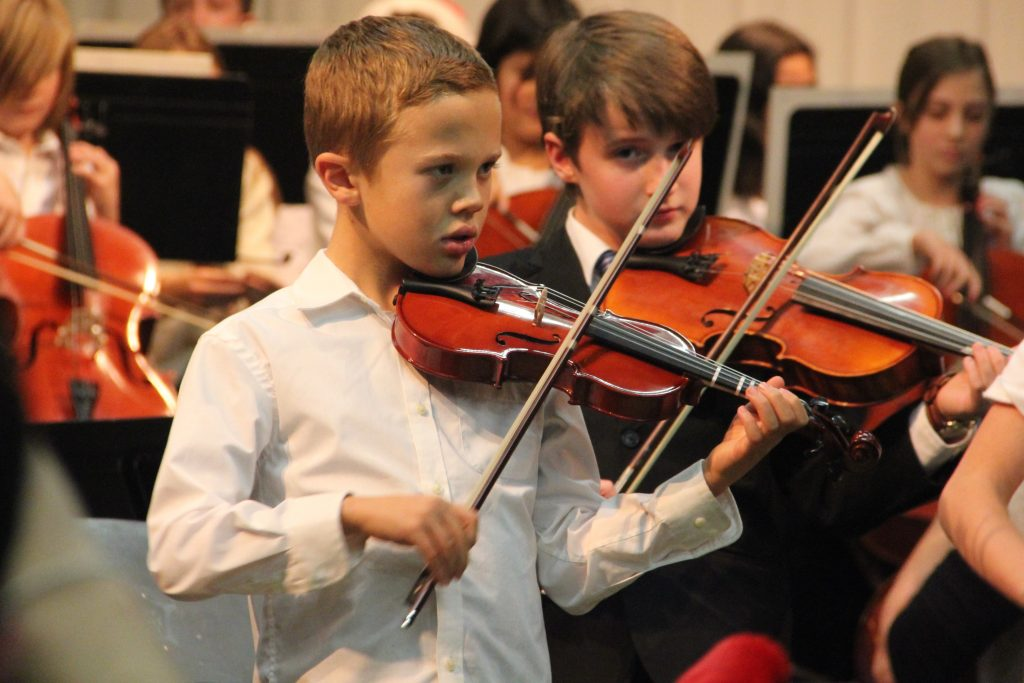 Jude playing viola at the school concert