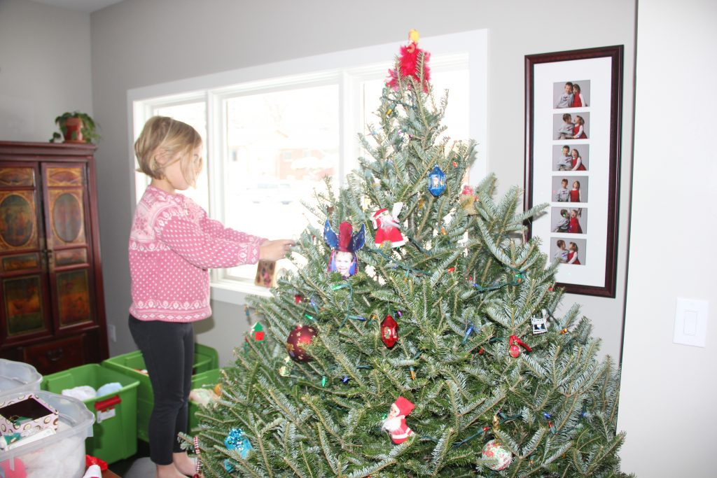 Anna decorating our Christmas tree