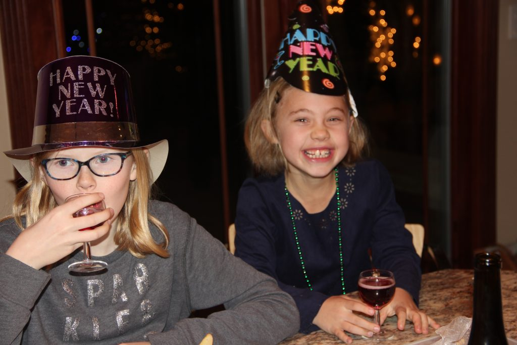 Anna and Lily enjoying a New Year's celebration