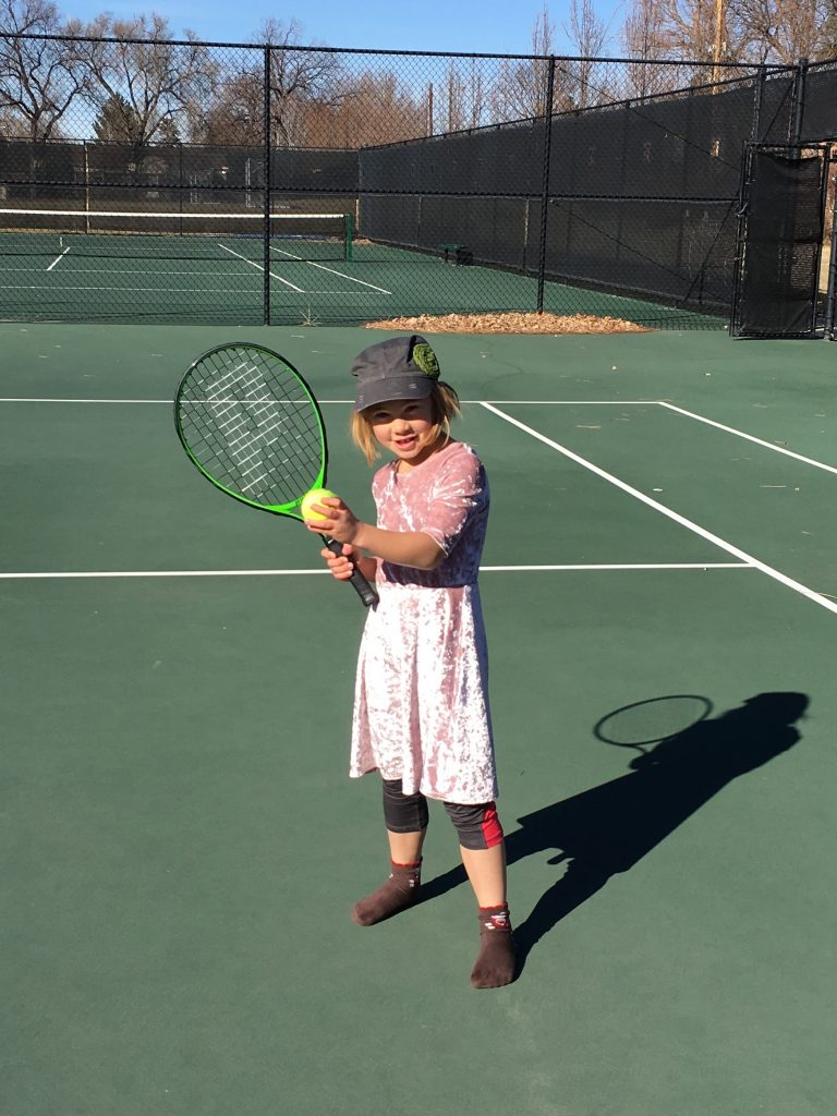 Anna showing off her new tennis racquet (and the no shoe look)