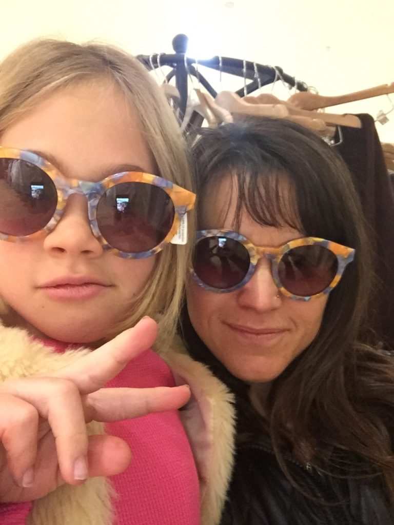 Trying on matching sunglasses on a Saturday shopping excursion