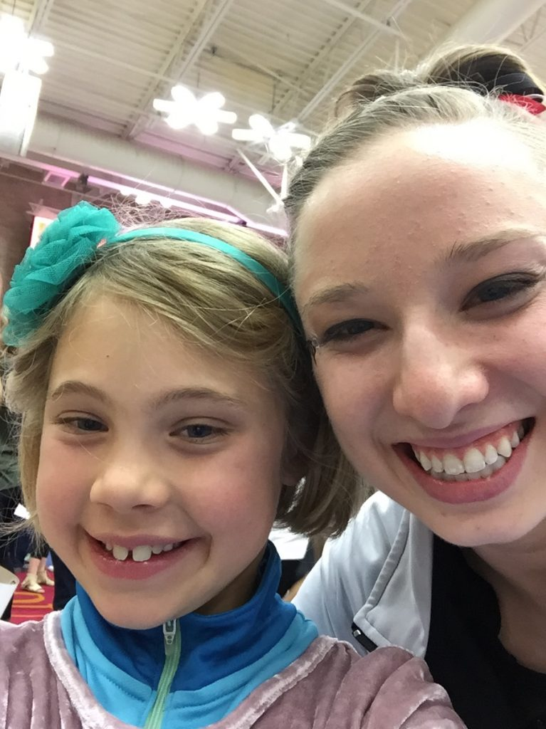 Anna with one of the DU gymnasts
