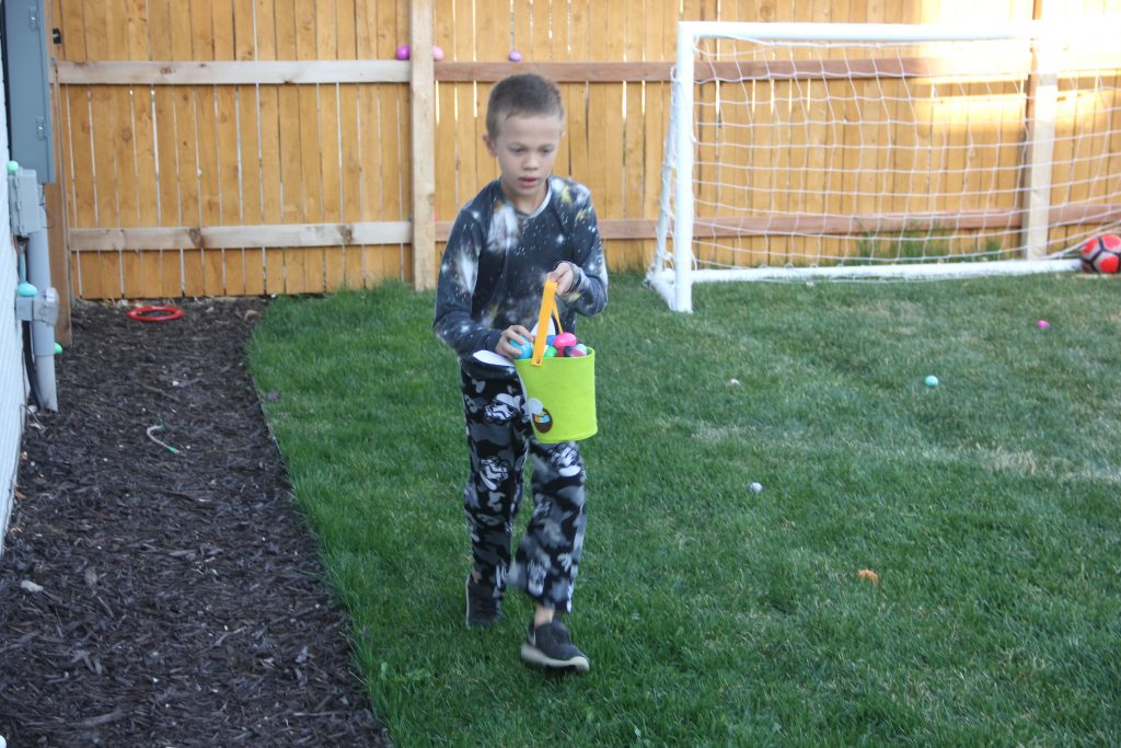 Jude focused on filling his basket in our backyard Easter Eggs hunt
