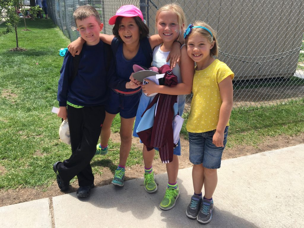 School out for summer! Anna with some classmates on the last day of school