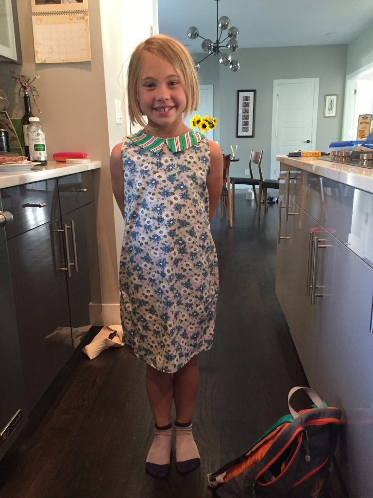 Anna wearing the new dress she made in sewing class