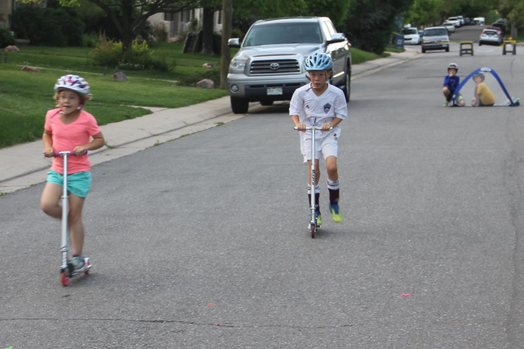 Anna and Jude in a scooter race