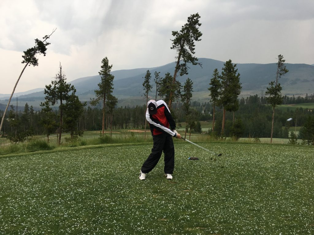 Nathan teeing off amidst the hail at the River Course