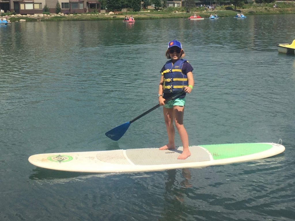 Anna trying stand up paddle boarding for the first time