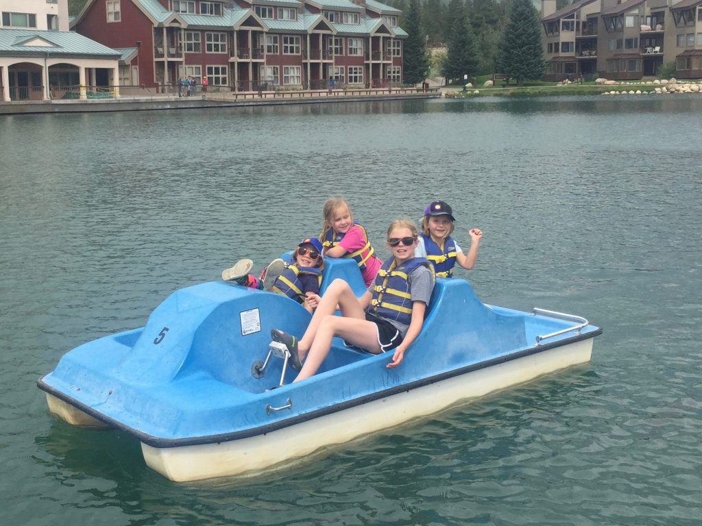 All the girl cousins rent a paddle boat on Keystone Lake