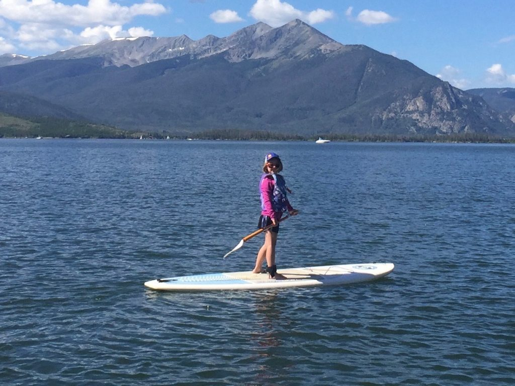 Anna took a stand up paddle boarding lesson on Lake Dillon