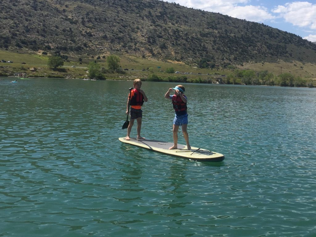 Anna and Reed share a paddle board