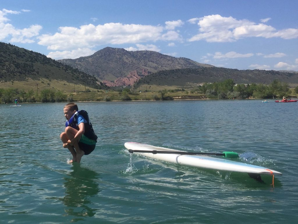 Jude doing a cannonball off his paddle board