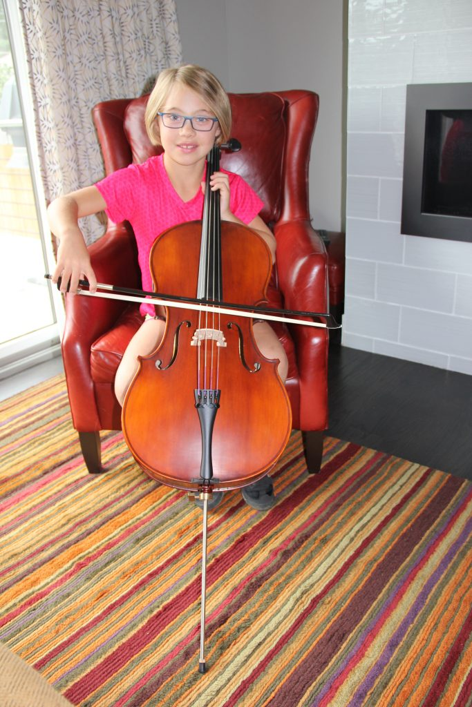 Anna playing her new cello for the first time