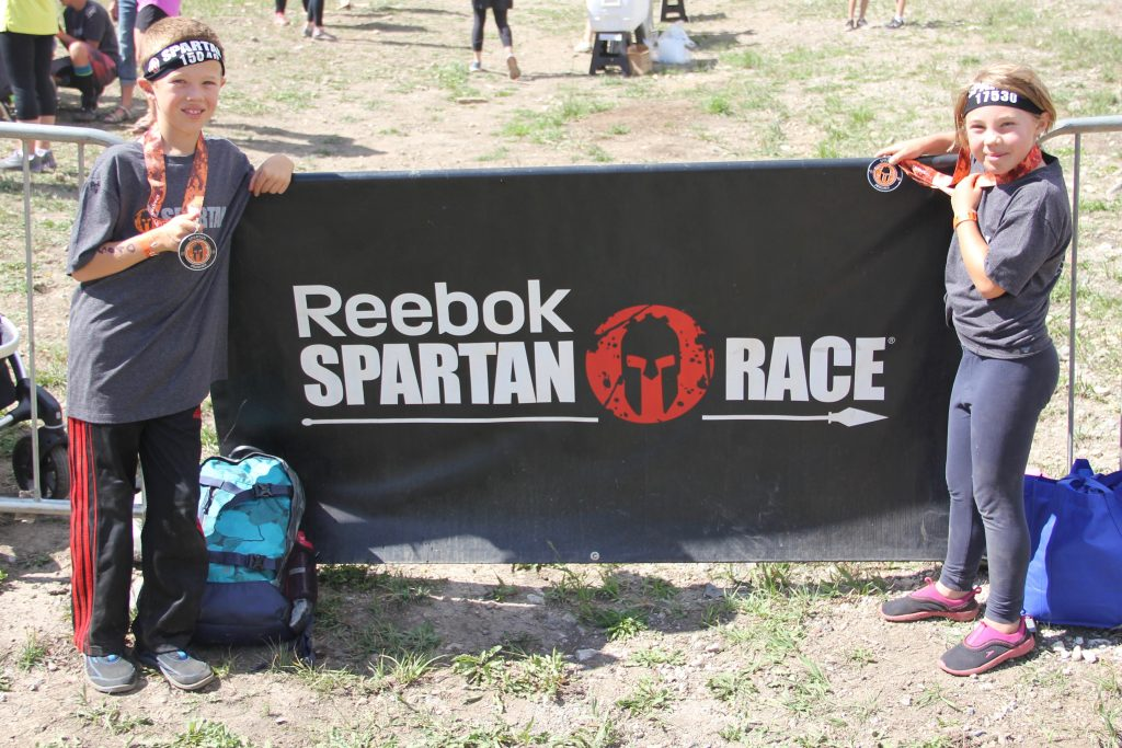 With their medals after their Spartan Race