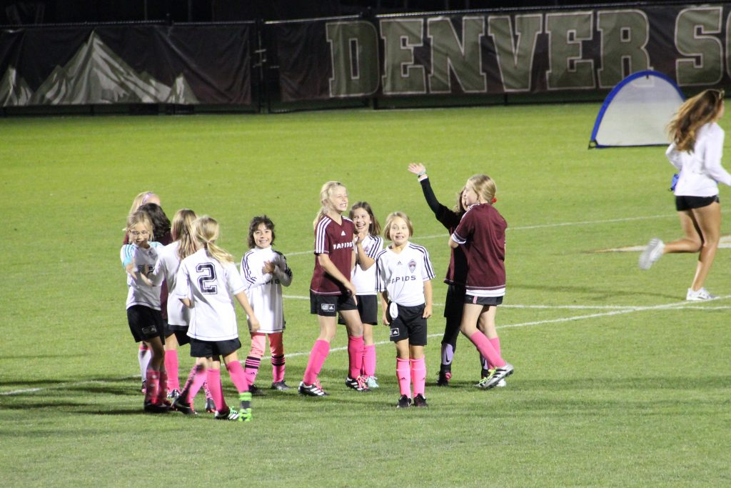Anna's soccer team playing on the DU soccer field