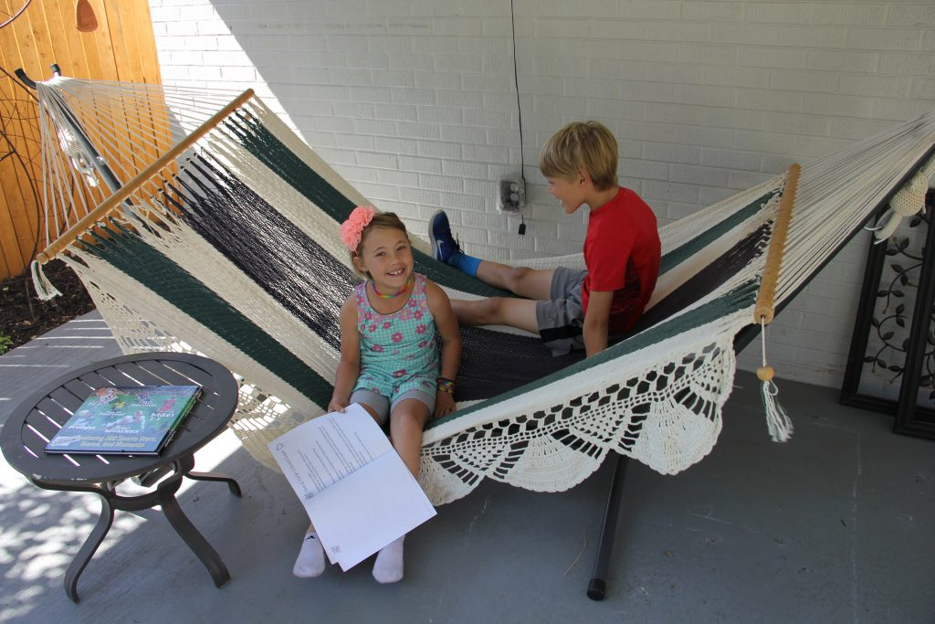 Anna and Reed enjoy the resurrection of the hammock