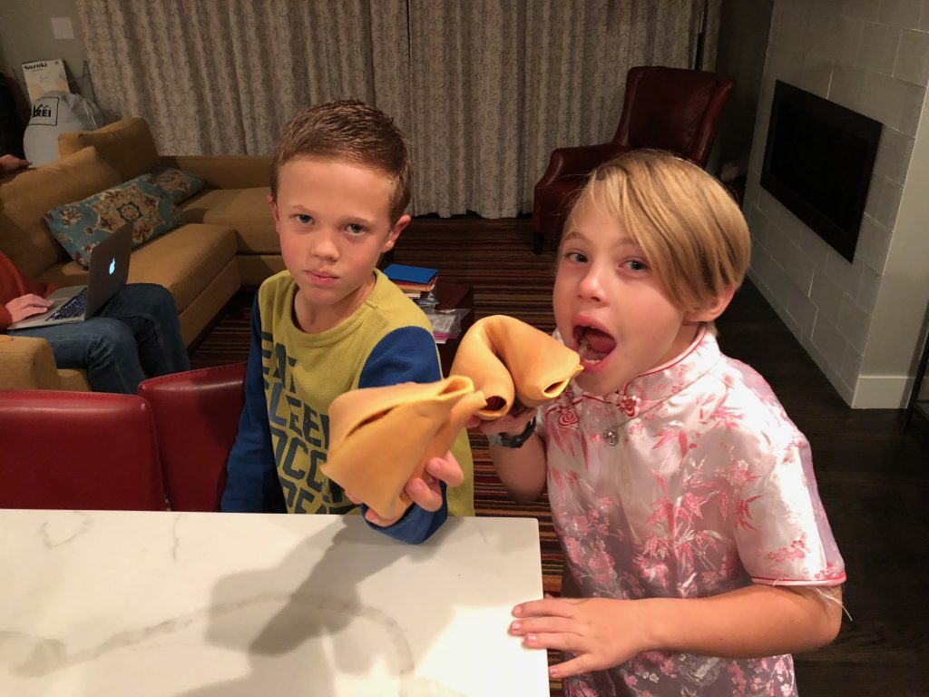 Anna and Jude with their giant fortune cookies from San Francisco