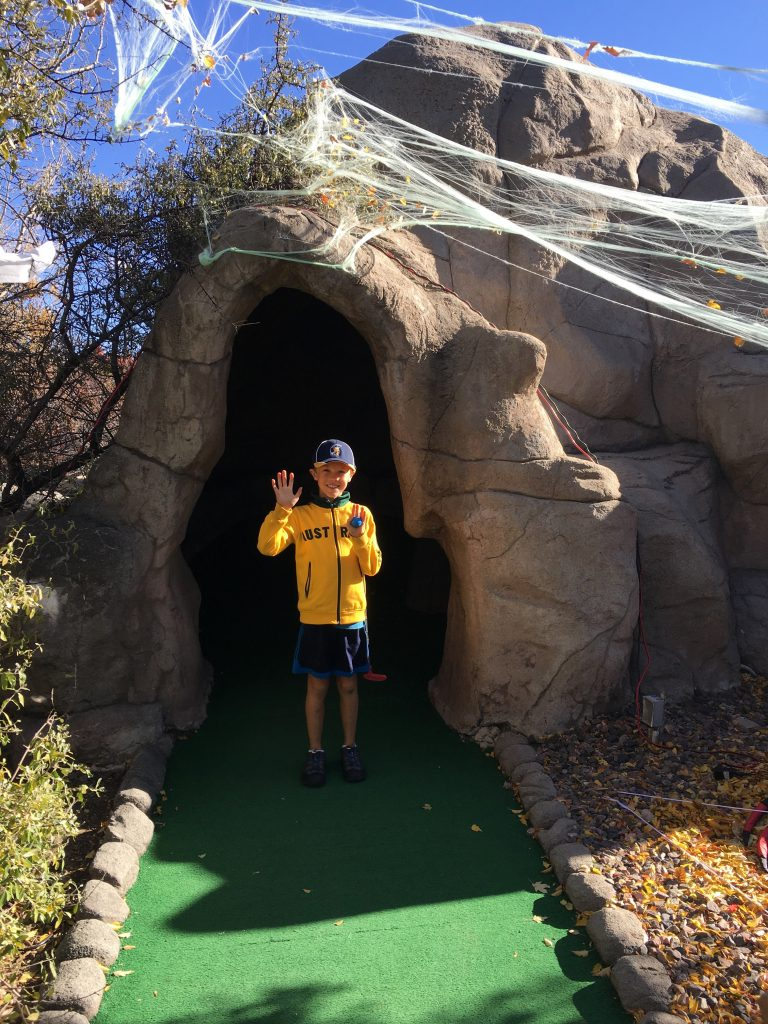 Jude at the Halloween-themed Colorado Journey mini golf course