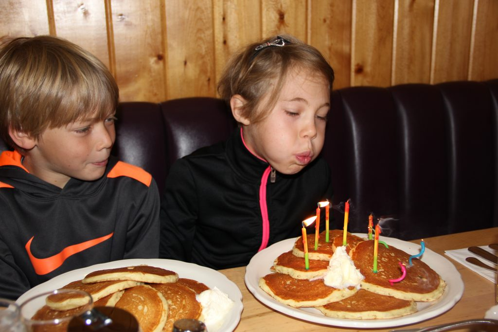 Blowing out her pancake candles at breakfast
