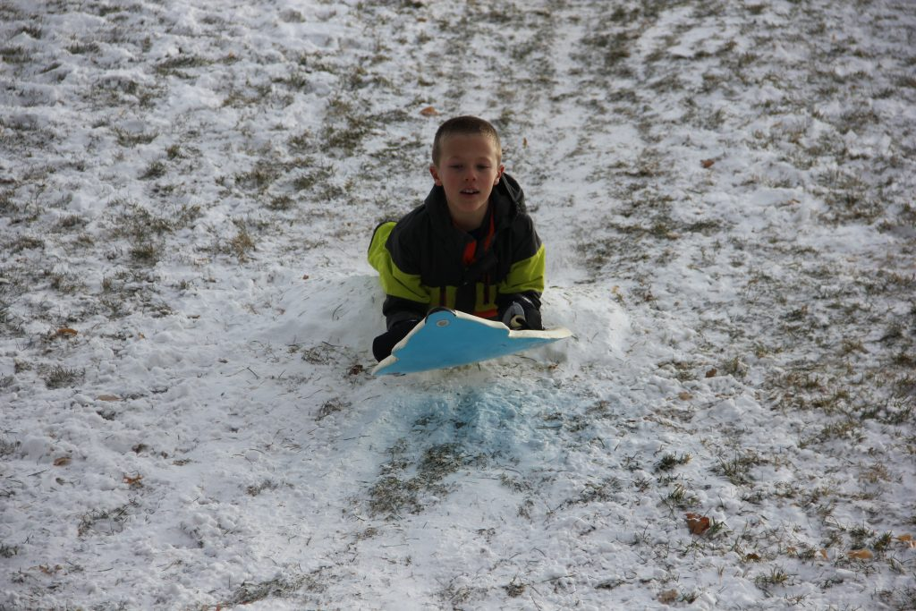 A couple of inches of snow was just enough for some fun sledding