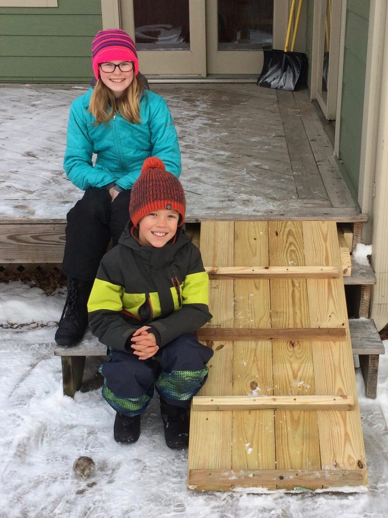 Jude and Lily helped Uncle Nathan make a ramp for their dog Buddy