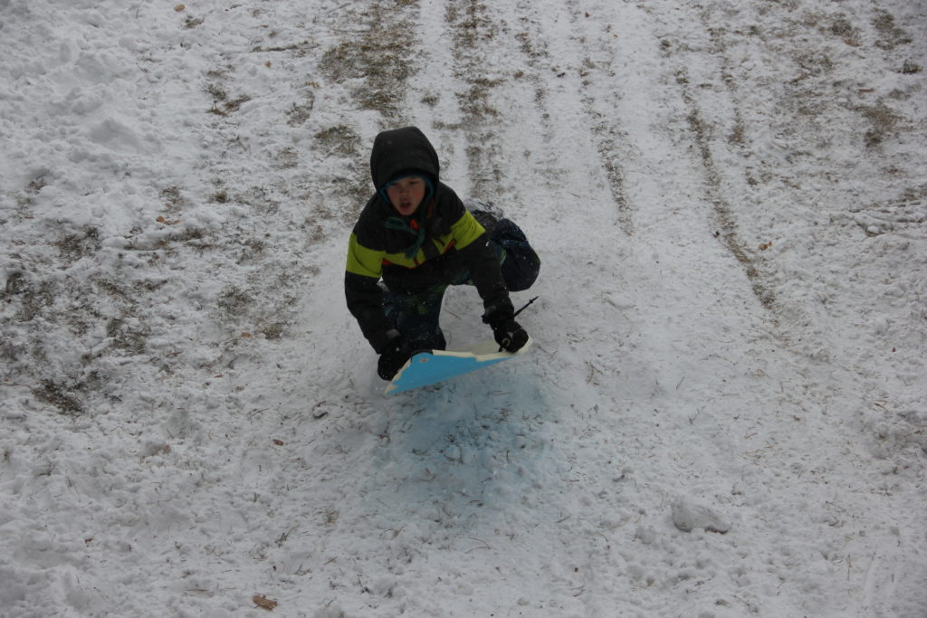 Jude shows his style over a jump they made sledding at the park