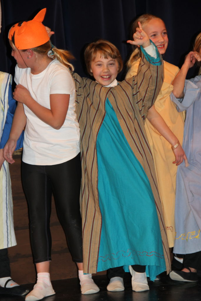 Anna in her Noah outfit celebrating the end of the play