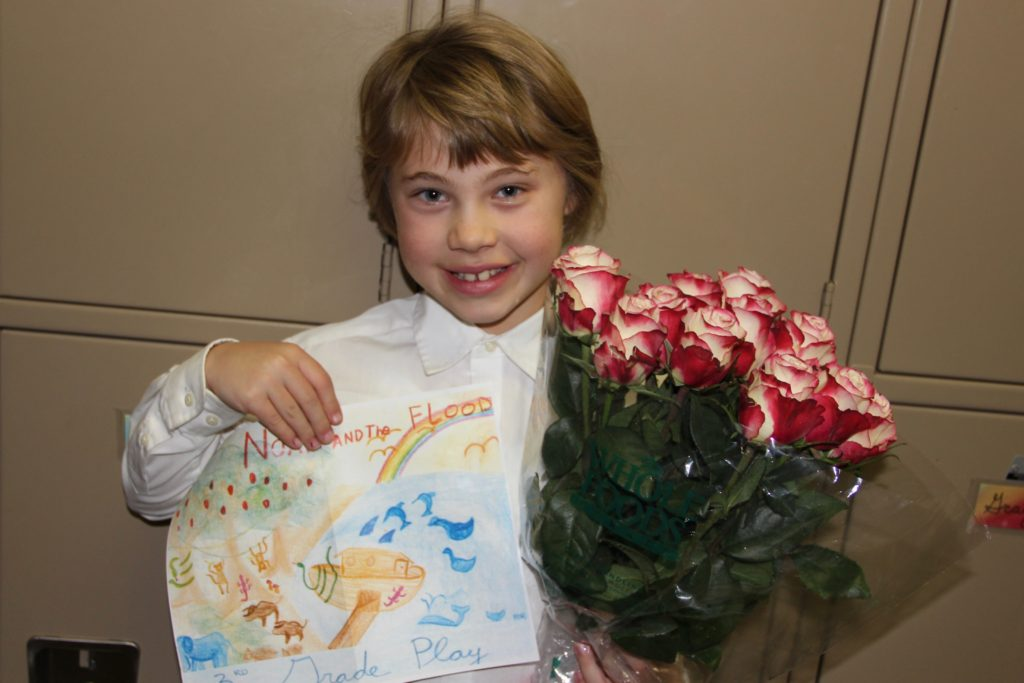 Anna after the play with some roses Marcy bought for her