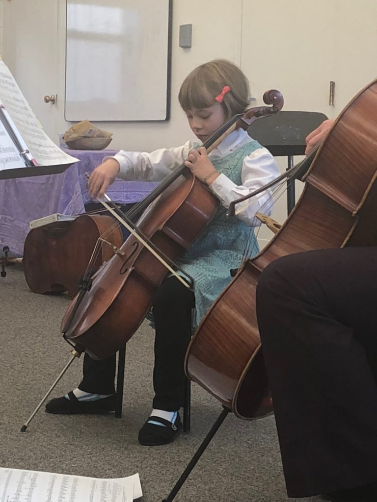 Anna playing her cello during her school recital
