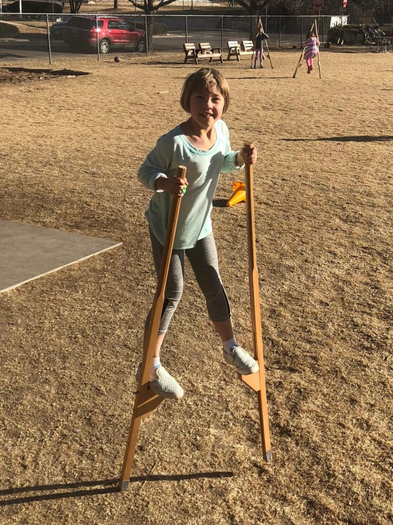 Early in the week Anna tried out stilts at school