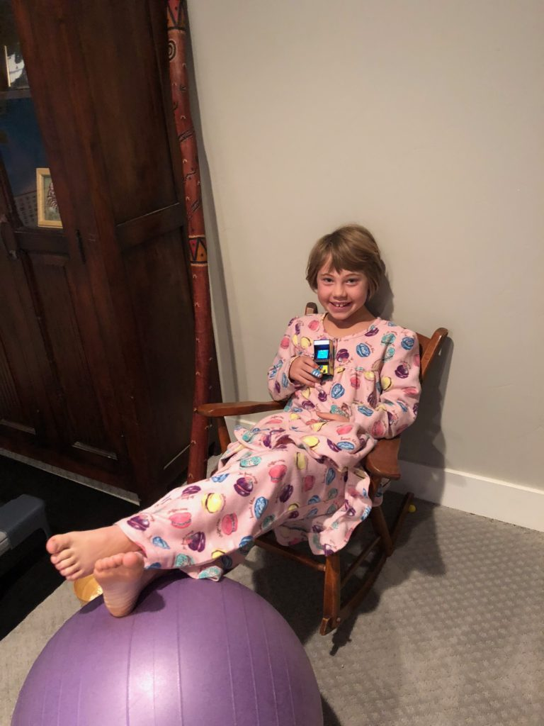 Anna sitting on the chair that was made for hew grandma (Baba) when she was a little girl