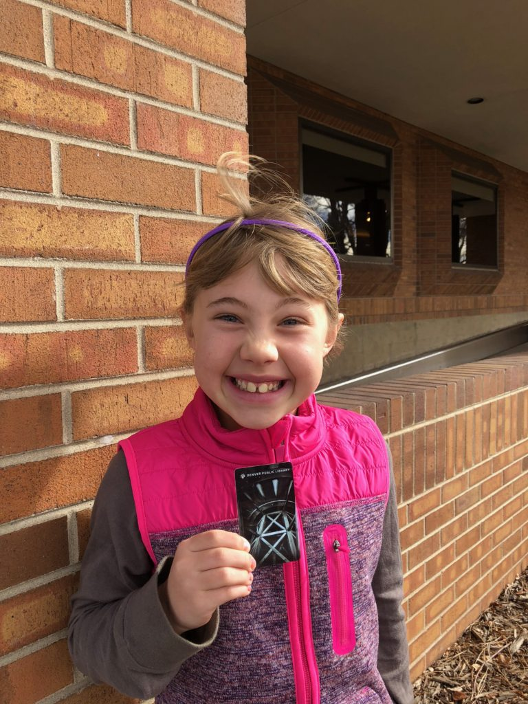 Anna shows off her new library card